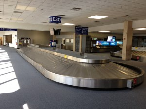 Baggage claim with speakers